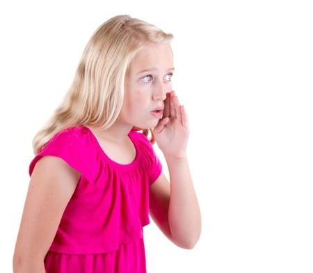 Girl whispering a secret, isolated on white background photo
