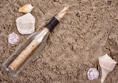 Message in a bottle on a sandy beach Stock Photo