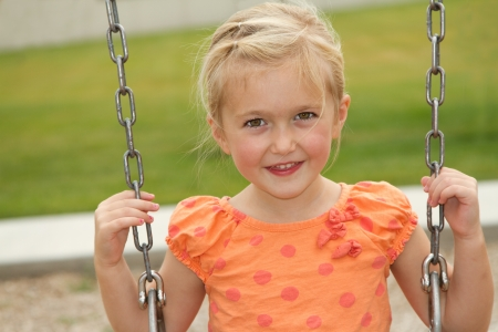 close-up of little or preschooler girl on swing  photo