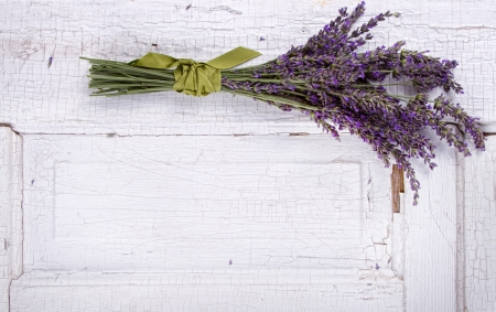 lavender laying on an old door panel, room for copy space photo