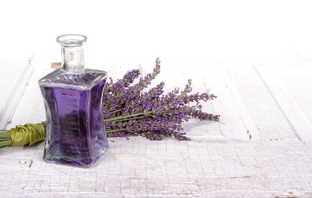 Lavender spa still life with bottle of lavendar infused oil on a vintage door photo