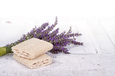 Lavender spa still life with loofah, on antique or vintage door