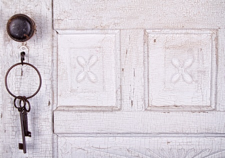 keyholes: Vintage key unlocking an  old cracked antique or vintage door