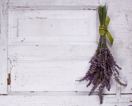 lavender laying on an old door panel, room for copy space Stock Photo