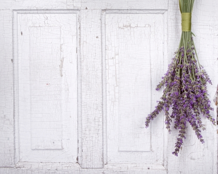 Lavendar hanging from an old vintage door, room for copy space photo