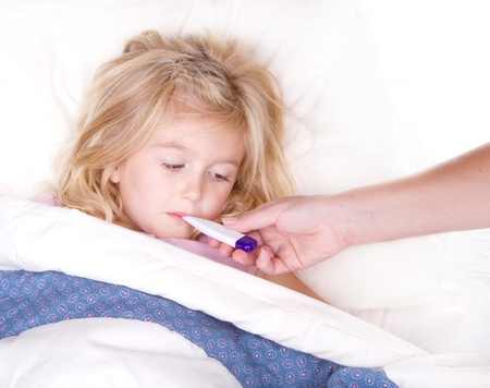 one sheet: sick child with a thermometer in mouth lying in bed