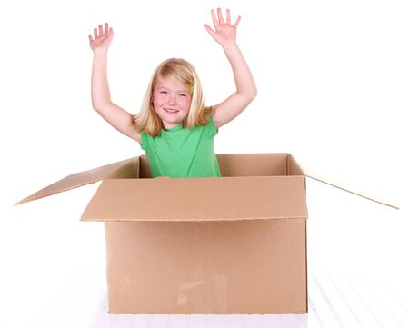 popping out: Girl popping out of cardboard box, on white