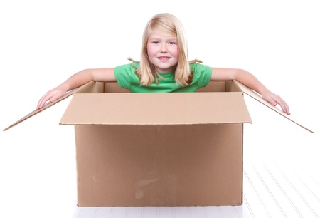 box big: girl in cardboard box, on white background Stock Photo
