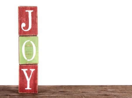 The word joy spelled out on blocks, isolated on white, Christmas ornaments. photo