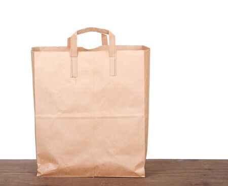 plain paper: Plain brown paper bag on white background