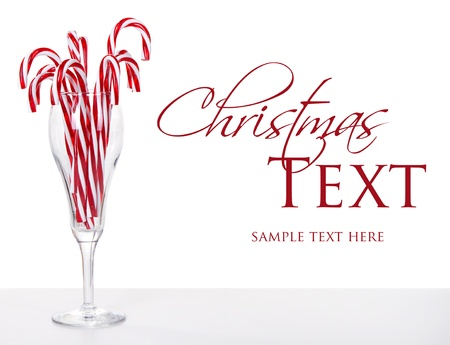 candy stripe: Many Candy canes in a wine glass  with an isolated white background