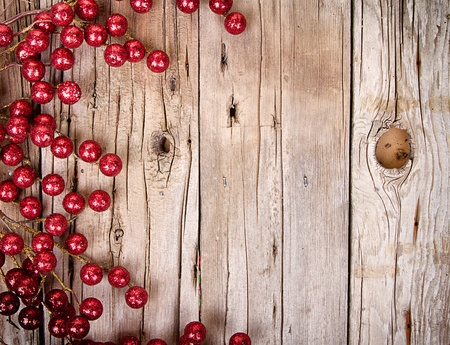 Christmas berries on aged wooden background photo