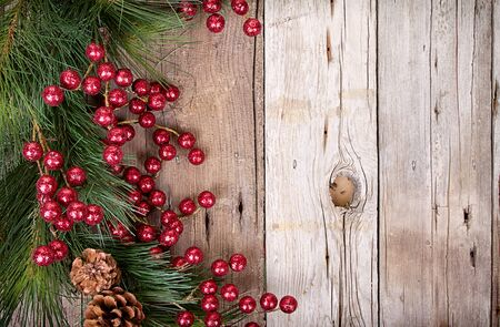 Pine branches with Christmas berries on wooden panels photo
