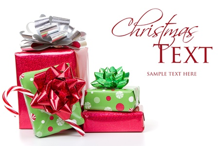 christmas stockings: Christmas presents stacked up on white background