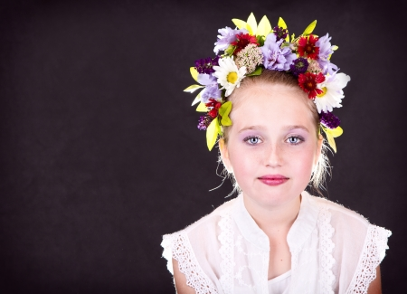 girl or teen with flowers in hair, dark background Stock Photo - 15912502