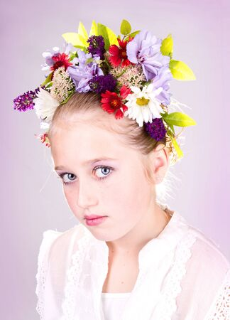 girl or teen with flowers in hair, light background 免版税图像
