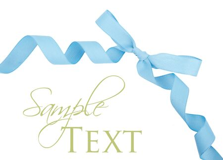 corner ribbon: Baby blue grosgrain ribbon and bow isolated on white.