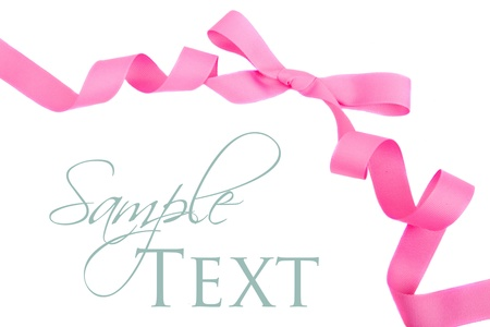 Pink grosgrain ribbon and bow isolated on white photo