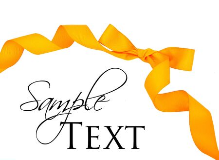 Orange ribbon and bow isolated on white photo