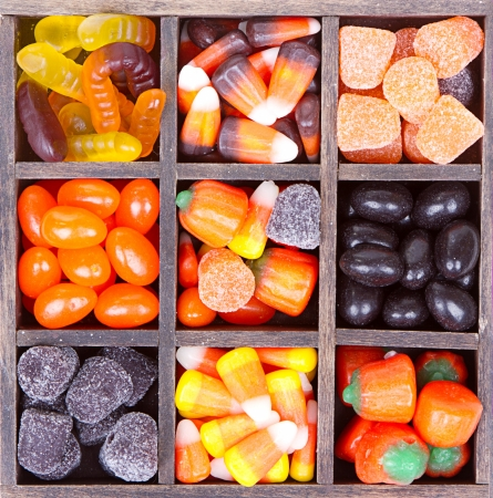 Halloween candy arranged in a square printers box photo