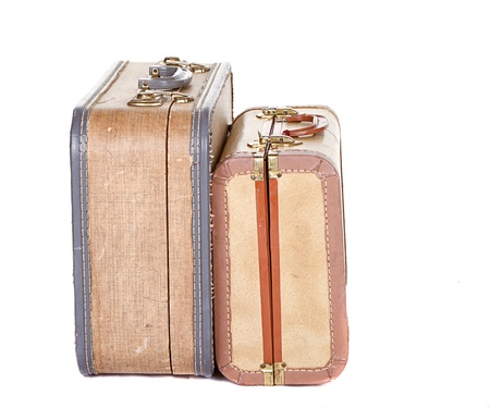 antique suitcase: Two vintage suitcases closed on their sides isolated on white Stock Photo