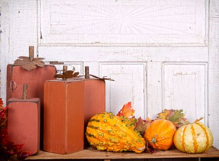 Wooden pumpkins autumn still life with gourds and antique panel background photo
