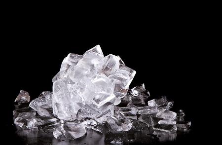 solid food: Ice melting on black background