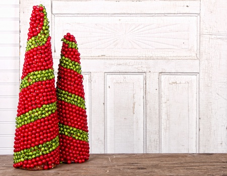 Christmas decorations made of berries in the shape of a cone with antique wooded panels for backround photo