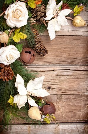 Christmas flowers and pine branches on wooden background photo