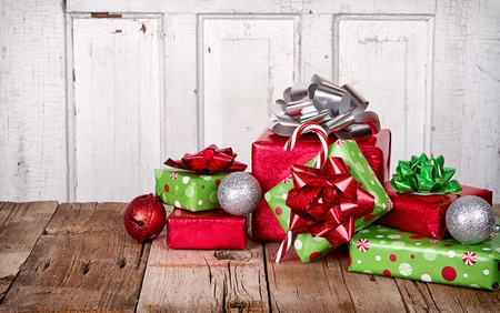 wood floor: Christmas Presents and Ornaments on Wooden Background Stock Photo