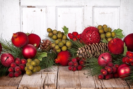 Christmas Fruit and ornaments with pine branches on a wooden background photo