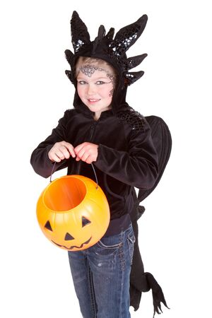 Child in Halloween costume dressed as a dragon photo