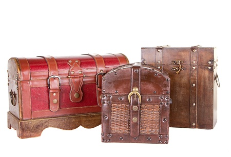 Group of three antique chests or trunks isolated on white photo