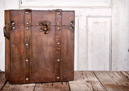 Wooden trunk or chest on an antique wooden backgrounds photo