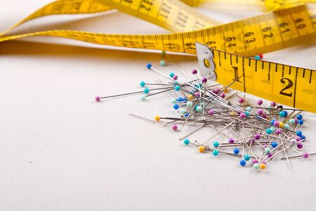sewing supplies: Sewing supplies, measuring tape, and  pins