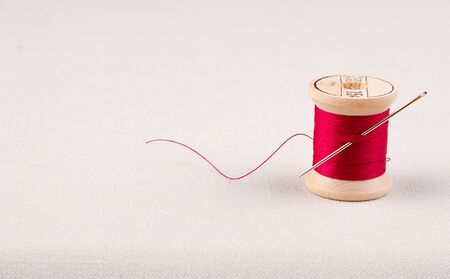 Sewing thread and needle on a material Stock Photo - 16758188