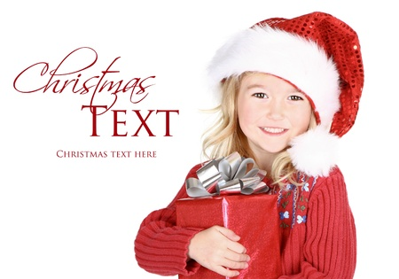 Child holding present wearin santa hat isolated on white