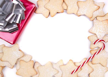 Christmas cookies framed on white with present and candy cane Stock Photo - 17194470