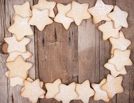 Star Christmas cookies framed on wooden background Stock Photo - 17194473