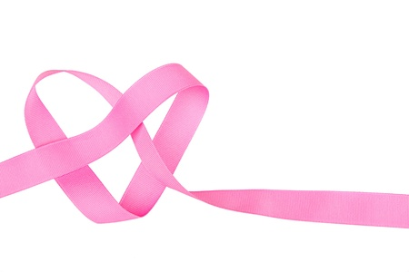 Pink ribbon in the shape of a heart isolated on white Stock Photo