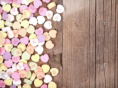 heart shaped: Heart shaped valentine candy on wooden background Stock Photo