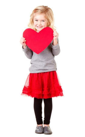 Little girl holding red heart, full lenth photo isolated on white