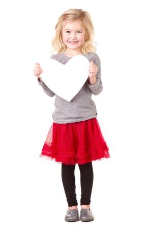 Little girl holding white heart, full lenth photo isolated on white photo