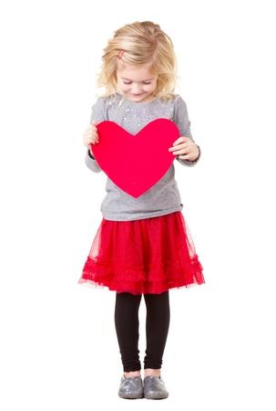 charming girl: Little girl holding red heart, full lenth photo isolated on white
