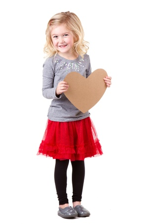 Little girl holding brown vintage heart, full lenth photo isolated on white