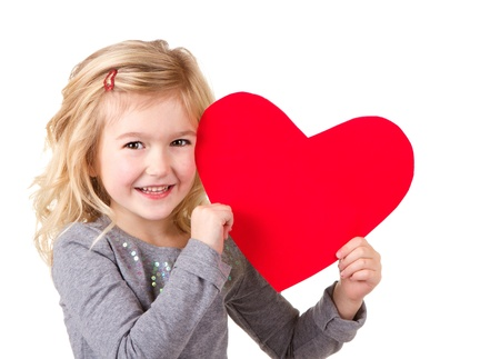 Little girl holding red heart, close-up isolated on white Standard-Bild