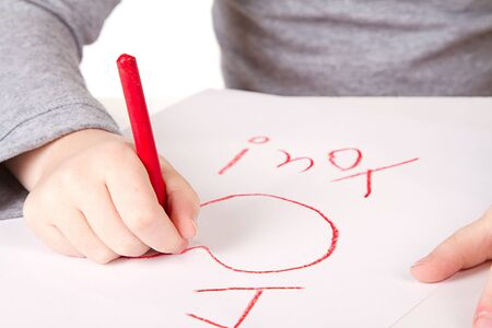 Child writting I love you close-up isolated on white photo