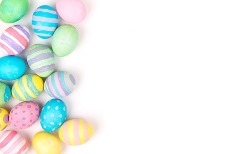 painted image: Easter eggs painted in pastel colors on a white background