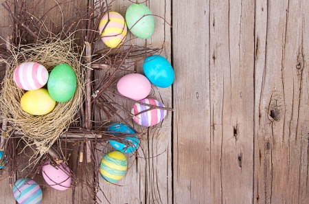 rustic: Easter eggs in nest on rustic wooden planks Stock Photo