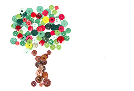 button: Apple tree made of buttons on denim white background